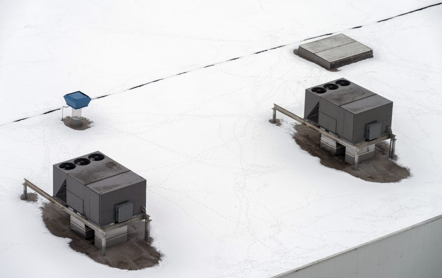 snow on roof of commercial building in winter